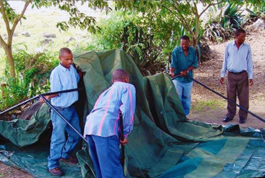 Putting up the tent for a participant examination
