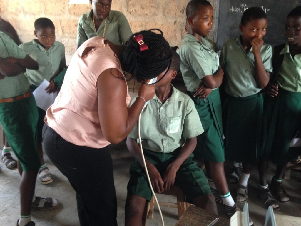 Past BCPB grantee Nnenne Uwa performing tonometry on students